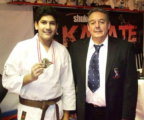 MIDAS TOUCH: Worcester's Ali Abbas with his gold medal pictured alongside club sensei Steve Farrow.