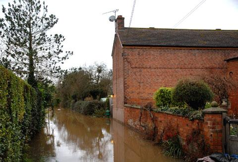 Worcester News: MAROONED: Jacky Smith's flooded home in Kempsey (4812186801)