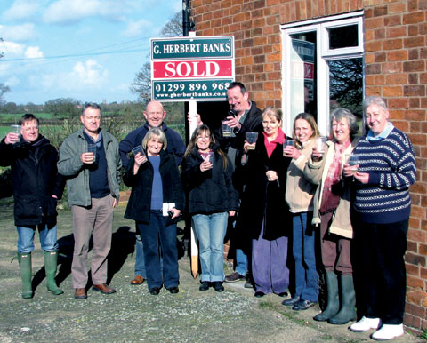 CELEBRATION: RSPCA volunteers celebrate the acquisition of the new rehoming centre but need all the help they can get.