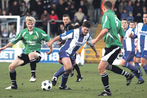 HEALTHY CROWD: Worcester City's Tom Thorley (left) battles for the ball in front of 2,500 fans at the Deva Stadium in their 4-2 defeat against Blue Square Bet North leaders Chester. Picture: CHESTER CHRONICLE