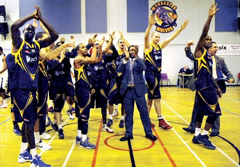 Worcester News: CELEBRATION TIME: Worcester Wolves head coach Paul James leads his players in thanking the fans after their victory over British Basketball League champions Newcastle Eagles at the University of Worcester. Picture: KEITH HUNT.