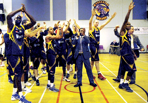 CELEBRATION TIME: Worcester Wolves head coach Paul James leads his players in thanking the fans after their victory over British Basketball League champions Newcastle Eagles at the University of Worcest
