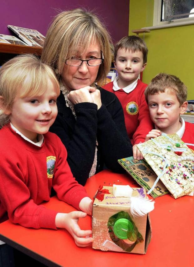 HANGING ON THE TELEPHONE: St Matthias Primary headteacher Claire Davies with, from left, Bonnie Davidson, Finley McCollum and Jay Conway. 4912194302