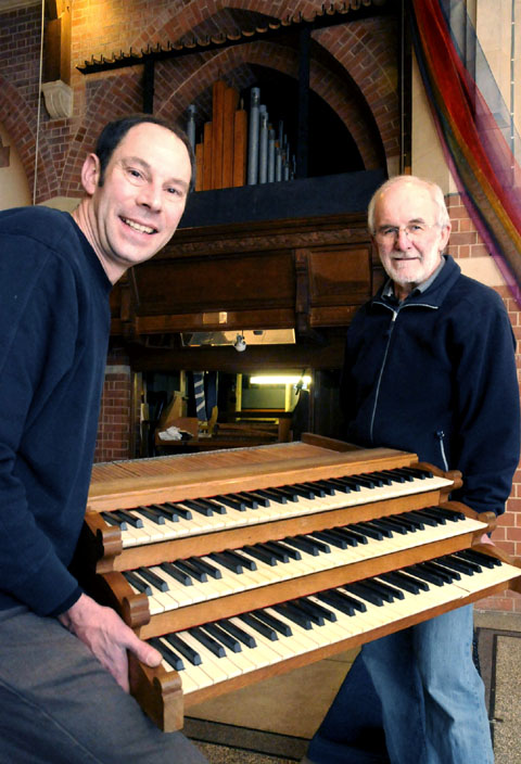 RESTORATION: John Faulkner, of W & A Boggis, and Bill Burton, of All Saints, with the organ which is thought to be the last of its kind in th