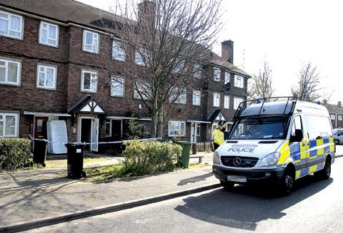 MURDER SCENE: Police cordon off Jackie Harrison's flat after finding her body (15013106)