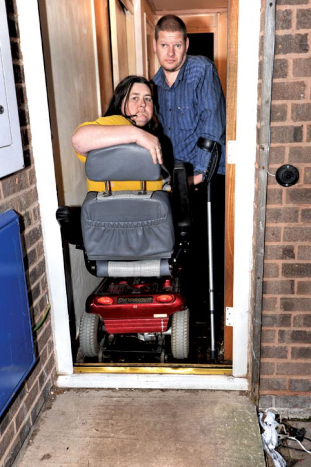 STUCK INSIDE: Lewis and Amanda Bishop at their doorway.
