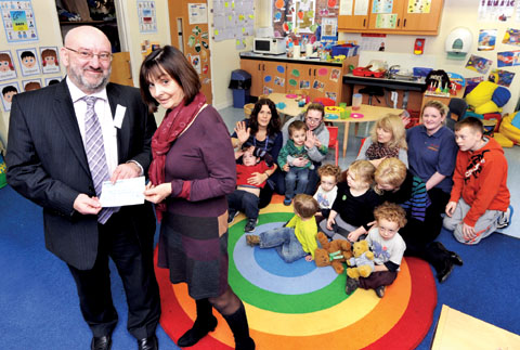 WINDFALL: Worcester News editor Peter John with Fort Royal Primary School headteacher Jane Long (5012202901)