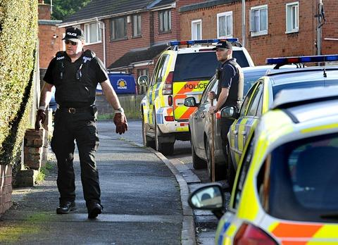 MURDER INQUIRY: Police at the scene of the killing in Teme Road, Worcester