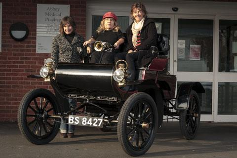 SHE'S IN THE DRIVING SEAT: Joy Rainey, centre, is raising money for research.