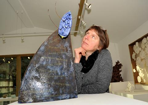 PROUD: Valerie Price-West with a piece of her work. 0113215701