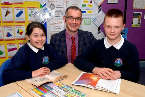 DELIGHT: Headteacher Justin Schiffman with pupils Megan Wood and Kurtis Rushton. Picture by Paul Jackson.