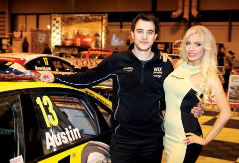 TOURING CAR BOOST: Pershore-based Rob Austin pictured with one of the grid girls at the Autosport International Show at the NEC in Birmingham.