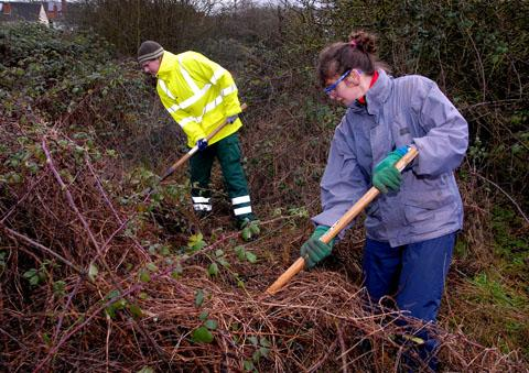 Wildlife ranger Steve Reynolds and Niki Lee of Diglis Residents' Group clear away scrub at Cherry Orchard Nature Reserve. Picture by Paul Jackson. 0213220101.