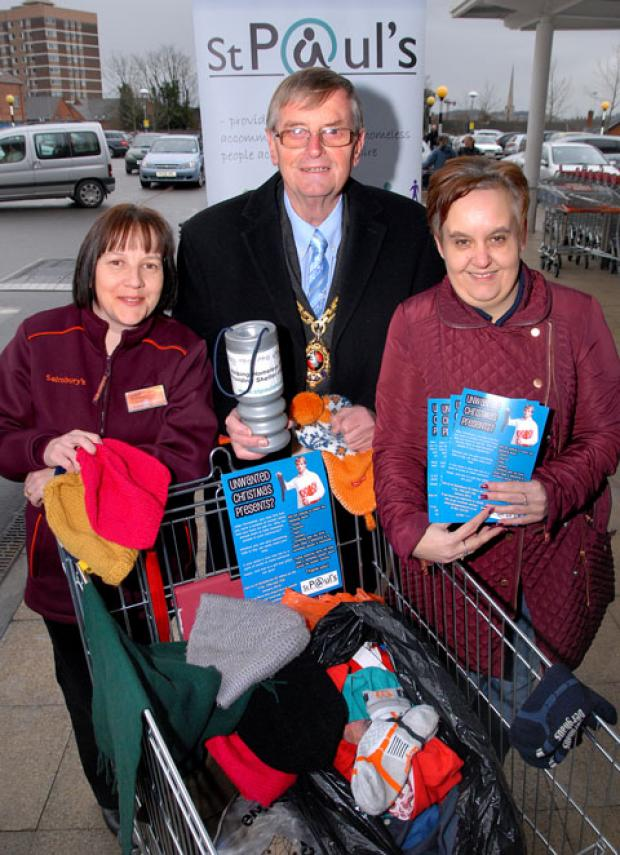 Louise Shaw, PR ambassador at Sainsbury's St John's, Mayor of Worcester Roger Berry and Lisa Richards, administrator and fundraiser for St Paul's Hostel, collect warm clothing at the hostel's donation drive. Picture by Paul Jackson. 0213220301.