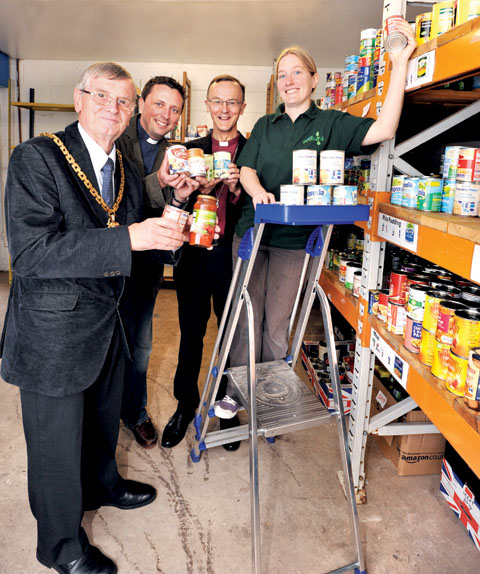 MORE HELP NEEDED: Ann-Marie Ison, right, Worcester Food Bank manager, with, from left, Mayor of Worcester Roger Berry, the Rev Rich Johnson and Bishop John.	25066802