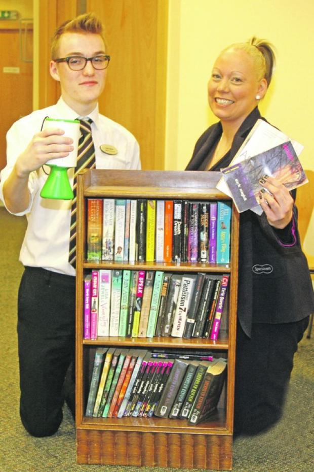 Well read: Luke Hanley, left, and Richenda Evans, of Specsavers, are helping raise funds.