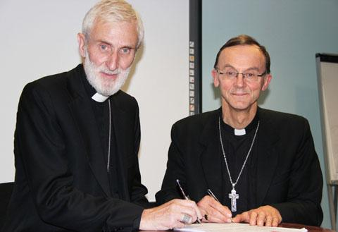 SPECIAL LINK: Bishop John right, signs a new partnership agreement with Bishop William Godfrey of Peru.