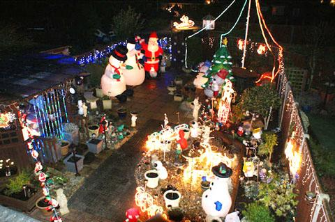 COLOURFUL: Mick Gale's garden was turned into Santa's garden