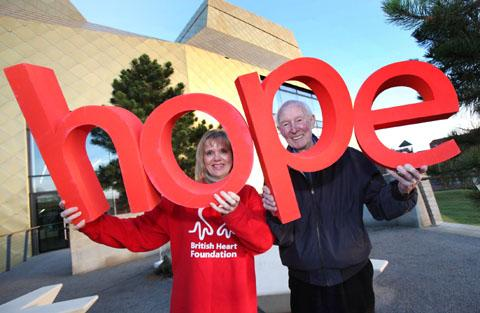 SUPPORTING WALK: Heart patient Stanley Smith, aged 85, outside the Hive in Worcester with Donna Stokes, the fund-raising volunteer manager for the British Heart Foundation.