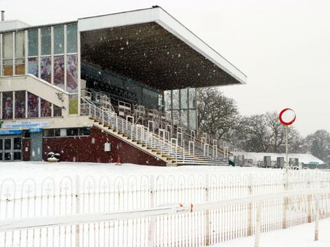 GRANDSTAND FINISH: Worcester Racecourse had a bleak outlook today as snow blanketed Pitchcroft. The rest of the weekend's county sport was similarly hit as winter struck.