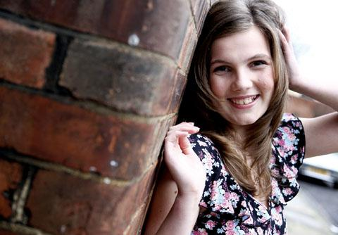 ALL SMILES: Teen queen hopeful Abi Grimshaw.