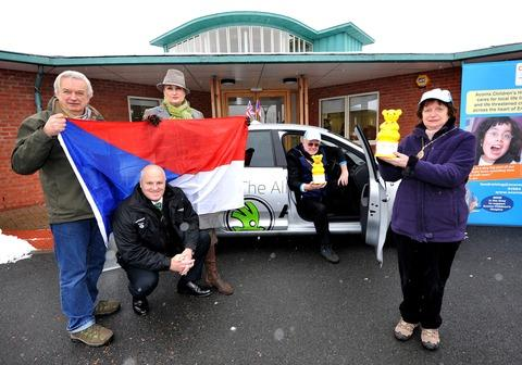 THE NEXT STOP IS EASTERN EUROPE: Mayor Ian Hopwood, in car, is joined by, left to right, Mark Young, Roy Tyler, of Startin, Mandie Fitzgerald and mayoress Janet Hopwood.