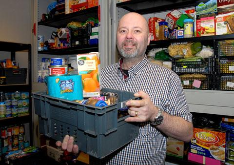 HELPING HAND: Steve Geal with some of the donated food that is being stored at Malvern's new foodbank.