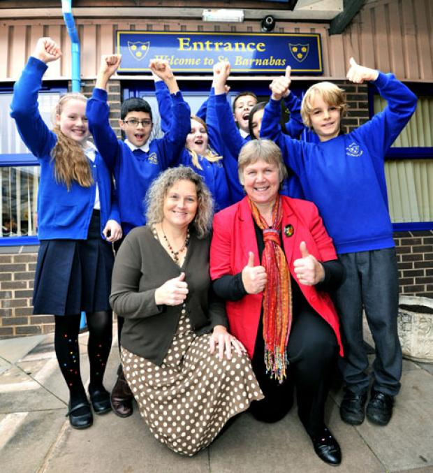 CELEBRATING: Deputy headteacher, Sarah Carey, front left, with headteacher Angela Deakin and pupils, from left, Melissa Griffiths, 10, Reece Faulkner, 11, Maddy Platt, 10, Cameron Blair, 10, Sachin Muir, 11 and Harvey Julian, 10.