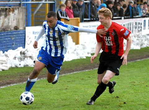 GOING FORWARD: Worcester City's Greg Mills makes a break down the wing in their 3-2 defeat to Histon.