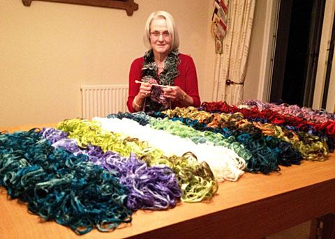 COLOURFUL SCARVES: Sue Fletcher helped to raise £700 for St Richard's Hospice thanks to her knitting exploits
