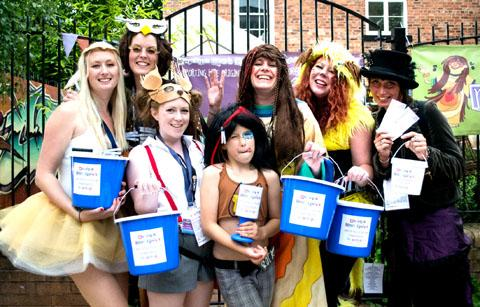ALL DRESSED UP: Staff at Worcester Arts Workshop kick off the search to find this year's music festival charity