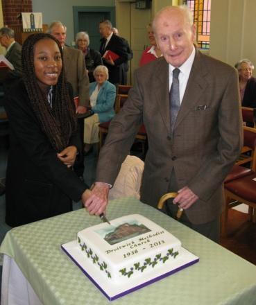 Ti Mbatha, one of the newest members of the church, cuts the anniversary cake with oldest member Ivor Wilkinson.