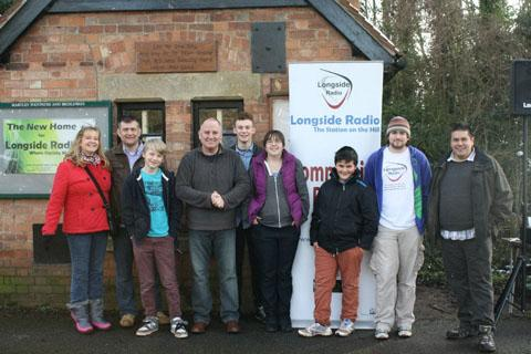 Worcester News: READY TO HELP: Mark Tibbutt, second left, with some of the people who came to the new home of Longside Radio.