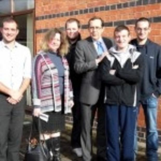 Worcester News: MP Peter Luff with staff and users of the YSS charity.