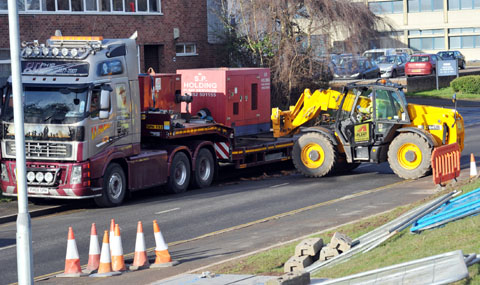 MOVING OUT: The pumps used during recent flooding are removed from Hylton Road, Worcester