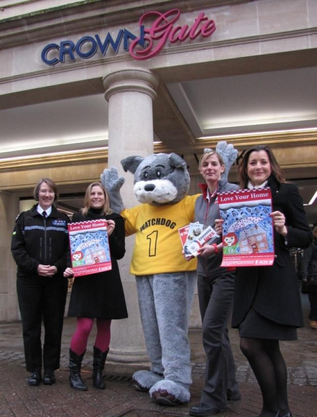 Insp Janet Heritage, Natalie Graham from Worcestershire Regulatory Services and mascot Watchdog, Erica Burlace from CrownGate and Becky Valender of Hereford and Worcester Fire and Rescue Service welcome residents to the Love Your Home shop.
