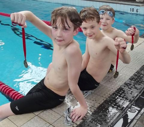 James Clews, 11, Ross Clews, nine, and Jake Clews, eight, from Droitwich, at the swimathon.