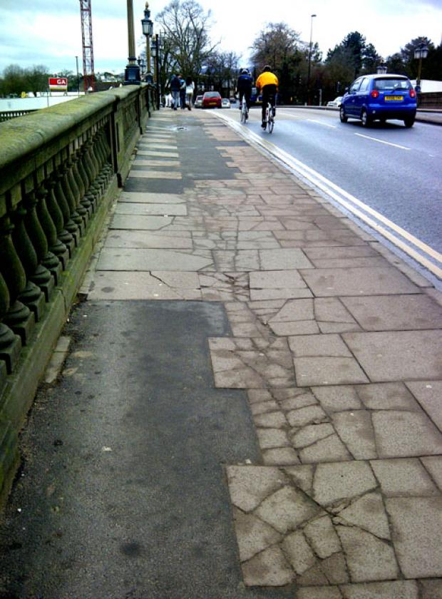 PATCHWORK: The uneven footpath on Worcester Bridge.