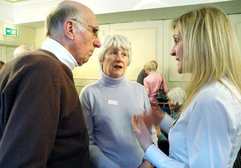 LET'S TALK: Clinical nurse specialist Elizabeth Pearce, right, talks to patients at the meeting.