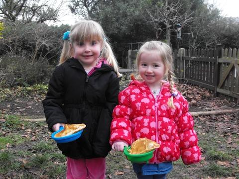 Amelia Lloyd-Rogers and Lily-Mae Doherty-Lawrence enjoy Pancake Day.