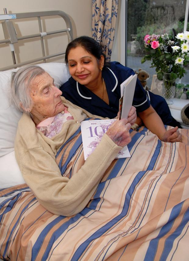 MILESTONE: Marjorie West with acting manager Hita Patel.