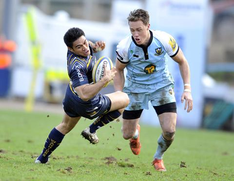 FALLING: Warriors' wing David Lemi attempts to stay on his feet against Northampton Saints during the 27-18 defeat at Sixways.