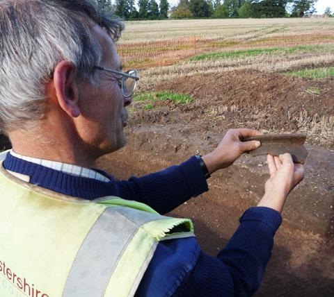 Worcester News: Archaeologist Derek Hurst holds two pieces of pot rim