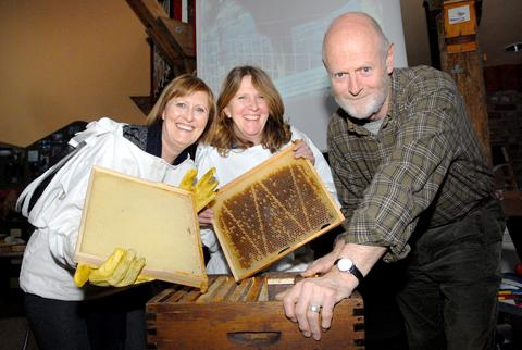 LEARNING: From left, Di Gibson and Dawn Murray with bee keeper Robin Hill. Picture by Nick Toogood. 0613240201