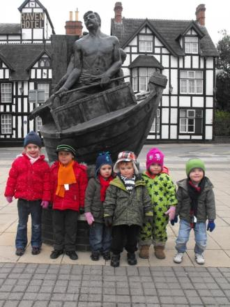 Bethany Childs, Oliver Marshall, Jacob Farrell, Christopher Dashey, Grace Dean and Callum Edwards from Bright Eyes Montessori Day Nursery next to the town's salt workers statue.