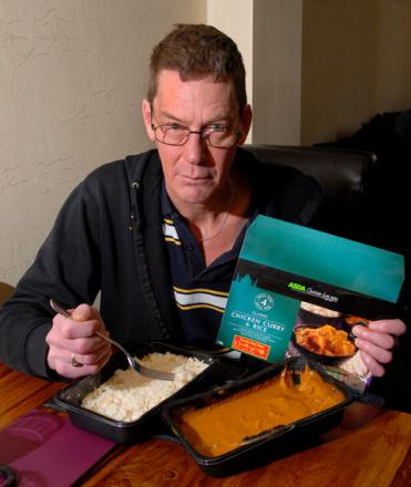 HAVING NAAN OF IT: Darren Ford with the Asda chicken curry he said contained no chicken. Picture: Paul Jackson. 0813253001