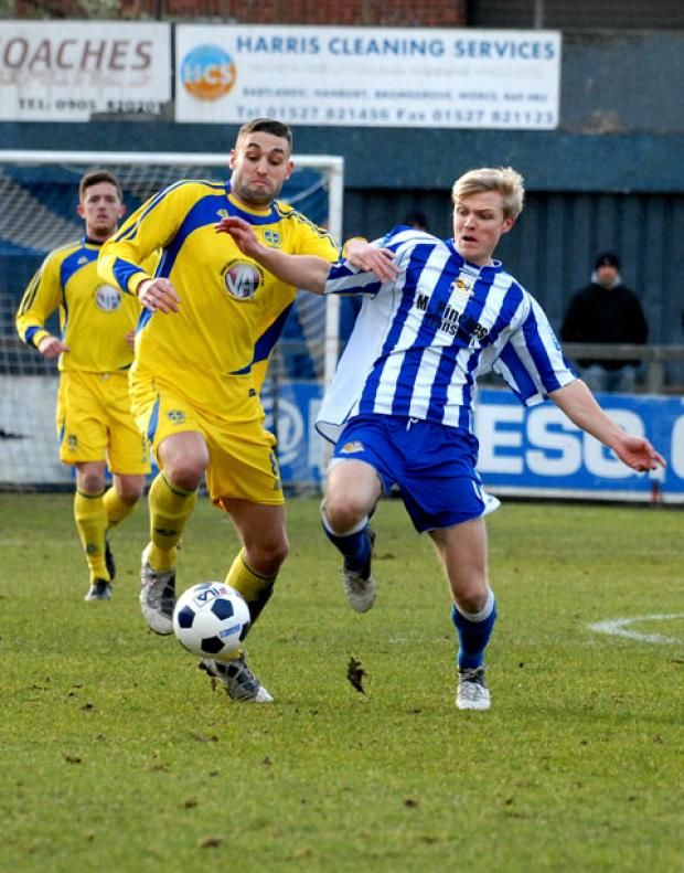 CHALLENGING TIMES: Worcester City's Tom Thorley (right) looks to make a tackle during his side's 1-0 defeat to Guiseley in Blue Square Bet North at St George's Lane.
