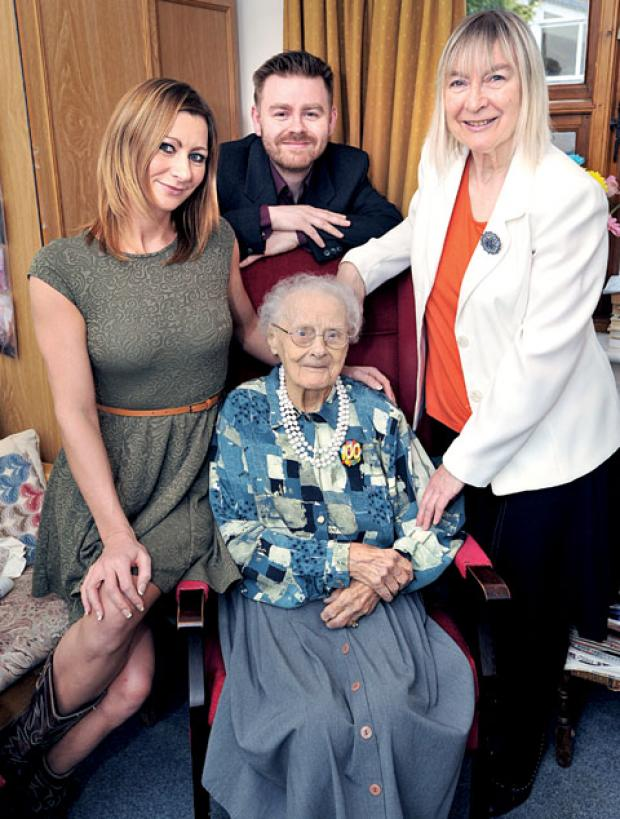 HUNDRED UP: Evelyn Jones celebrates her 100th birthday at South Hayes Care Home with great niece Gemma Brown, left, great nephew Richard Brown, and niece Valerie Brown.