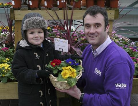 Marcus Osborne, four, and his dad Jason get ready for the Mothers' Day potting workshop at Webbs.