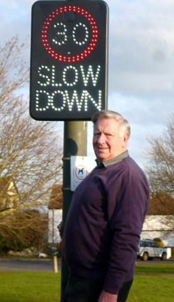 DETERRENT: Councillor John Smith with the sign.